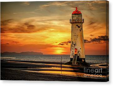 Sunset At The Lighthouse Canvas Print by Adrian Evans