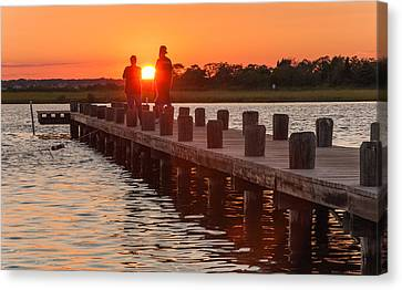 Sunset Couple Canvas Print by Kristopher Schoenleber