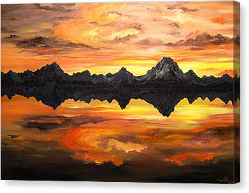 Sunset Over Jackson Lake And The Grand Tetons Canvas Print by Connie Tom