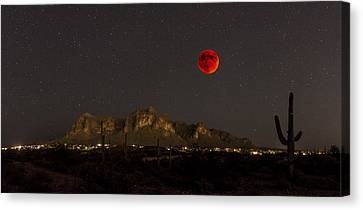Super Bloodmoon Over The Superstition Mountains Canvas Print by Chuck Brown