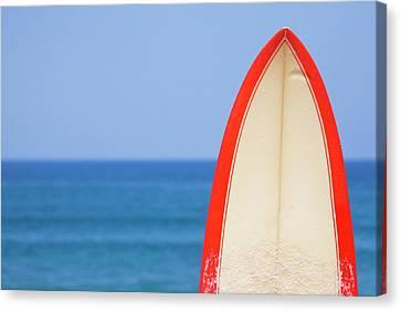 Surfboard By Sea Canvas Print by Alex Bramwell