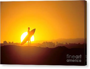 Surfer Silhouetted At Sun Canvas Print by Erik Aeder - Printscapes