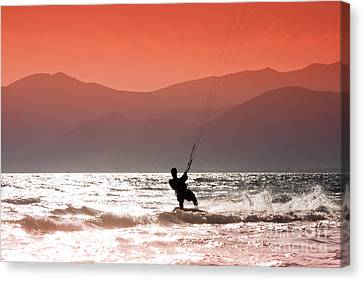 Surfing Into The Sunset Canvas Print by Gabriela Insuratelu