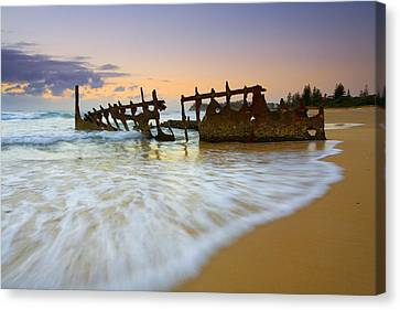 Swallowed By The Tides Canvas Print by Mike  Dawson
