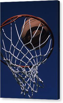Swish.  A Basketball Canvas Print by Stacy Gold