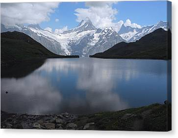 Swiss Alps And Clouds Casting Canvas Print by Anne Keiser