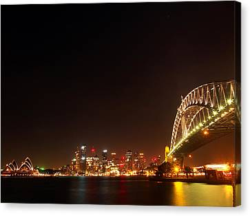 Sydney By Night Canvas Print by Justin Woodhouse