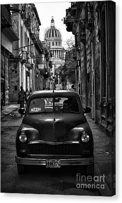 Taxi In Havana Canvas Print by Jose  Rey