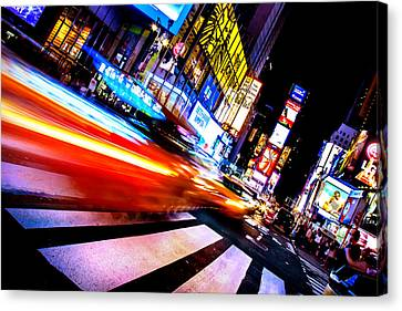 Taxis In Times Square Canvas Print by Az Jackson