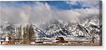 Teton Mountains Over Mormon Row Canvas Print by Adam Jewell