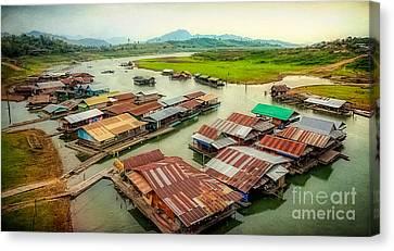 Thai Floating Village Canvas Print by Adrian Evans