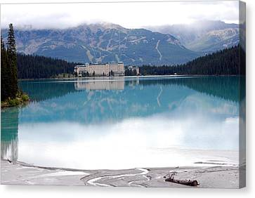 The Chateau At Lake Louise Canvas Print by Harvey Barrison