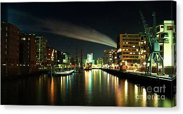 The Docks Of Hamburg By Night Canvas Print by Rob Hawkins