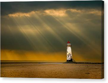 The Lighthouse As The Storm Breaks Canvas Print by Meirion Matthias