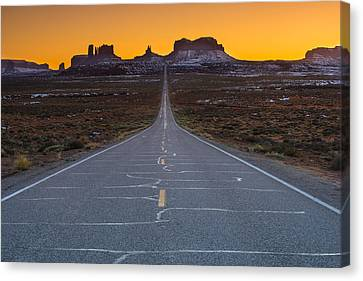 The Long Road To Monument Valley Canvas Print by Larry Marshall