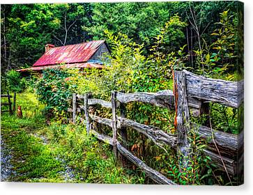 The Old Fence Canvas Print by Debra and Dave Vanderlaan