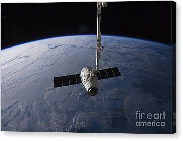 The Spacex Dragon Cargo Craft Canvas Print by Stocktrek Images
