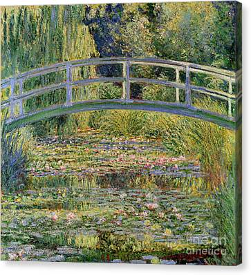 The Waterlily Pond With The Japanese Bridge Canvas Print by Claude Monet