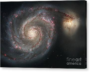 The Whirlpool Galaxy M51 And Companion Canvas Print by Stocktrek Images
