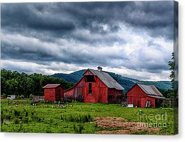 Threatening Sky And Barn Canvas Print by Thomas R Fletcher