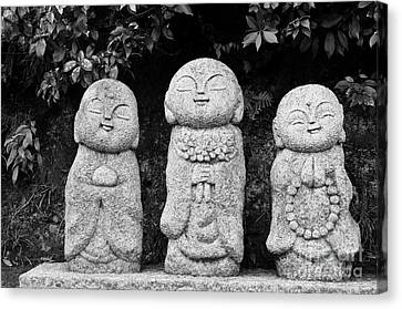 Three Happy Buddhas Canvas Print by Dean Harte