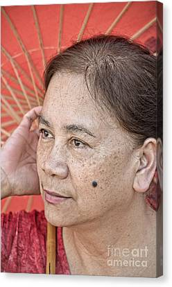 Three Quarter Portrait Of A Freckle Faced Filipina With A Mole On Her Cheek  Canvas Print by Jim Fitzpatrick
