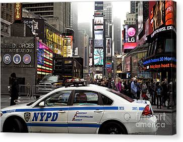 Times Square Police Car Canvas Print by John Rizzuto