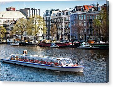 Touristic Boat At Amsterdam Canal Canvas Print by Jenny Rainbow