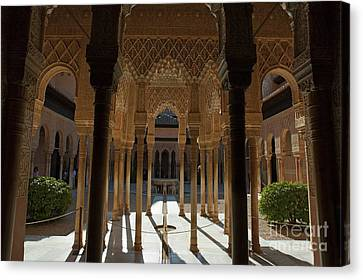 Tourists In The Courtyard In The Patio De Los Leones Area At Alhambra Canvas Print by Sami Sarkis