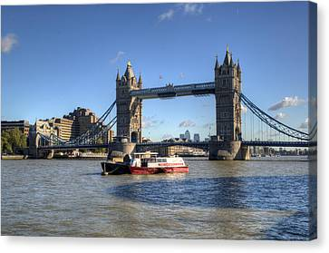 Tower Bridge With Canary Wharf In The Background Canvas Print by Chris Day