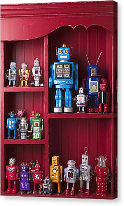 Toy Robots On Shelf  Canvas Print by Garry Gay