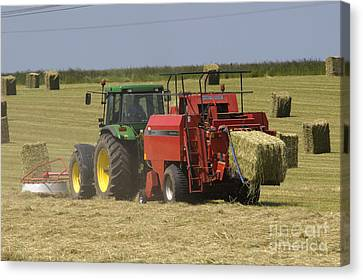 Tractor Bailing Hay At Harvest Time Canvas Print by Andy Smy