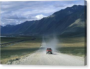 Truck On The Dalton Highway Following Canvas Print by Rich Reid