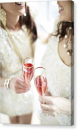 Two Giggling Ladies Toasting Champagne Canvas Print by Gillham Studios