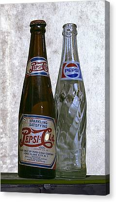 Two Pepsi Bottles On A Table Canvas Print by Daniel Hagerman