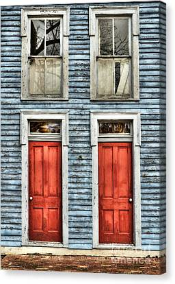 Two Red Doors Canvas Print by Mel Steinhauer