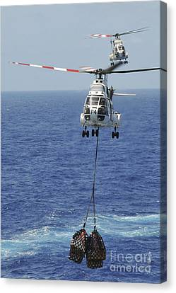 Two Sa-330 Puma Helicopters Deliver Canvas Print by Stocktrek Images
