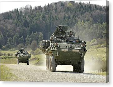 Two Stryker Vehicles At The Hohenfels Canvas Print by Stocktrek Images