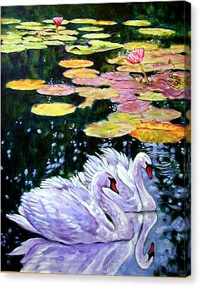 Two Swans In The Lilies Canvas Print by John Lautermilch