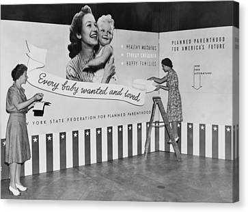 Two Women Working On Panels For Exhibit Canvas Print by Everett
