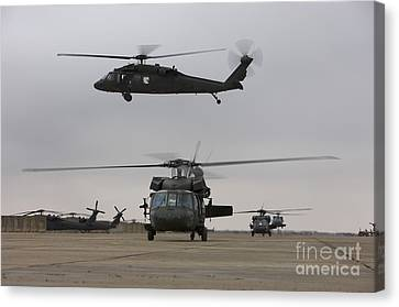 Uh-60 Black Hawks Taxis Canvas Print by Terry Moore