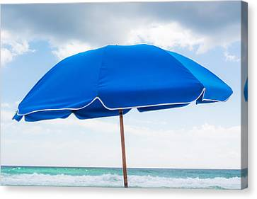 Umbrella On The Beach Canvas Print by Shelby  Young