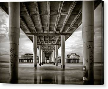 Under The Boardwalk Canvas Print by Dave Bowman