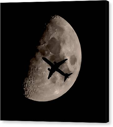 Under The Moons Shadow Canvas Print by Martin Newman