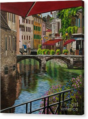 Under The Umbrella In Annecy Canvas Print by Charlotte Blanchard