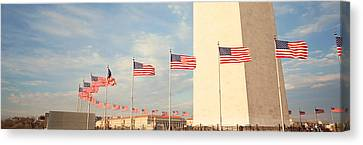United States Flags At The Base Canvas Print by Panoramic Images