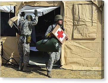 U.s. Air Force Soldier Exits A Medical Canvas Print by Stocktrek Images