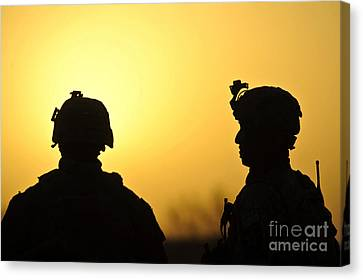U.s. Army Soldiers Silhouetted Canvas Print by Stocktrek Images