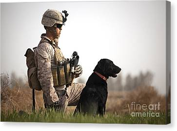 U.s. Marine Holds Security In A Field Canvas Print by Stocktrek Images