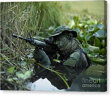 U.s. Navy Seal Crosses Through A Stream Canvas Print by Tom Weber
